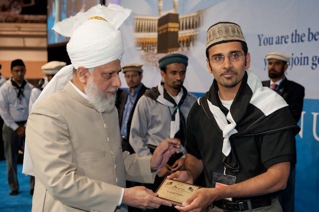 Asad Chaudhry receiving a volunteer services achievement award from His Holiness Mirza Masroor Ahmad,the Khalifa of Islam and head of the Ahmadiyya Muslim Community. Thousands are expected to make the pilgrimage to see international Muslim leader during his U.S. tour.