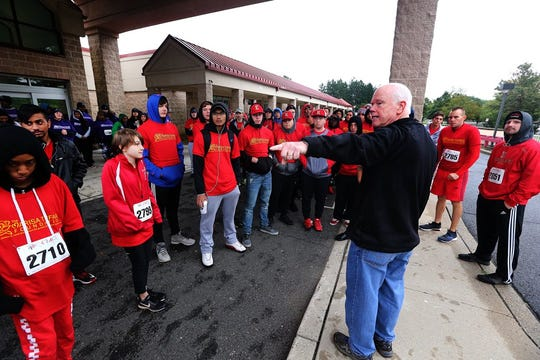 Senator Patrick J. Diegnan talks to some of the Edison High School students who participated in Saturdays Race to Outrun Hunger
