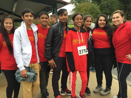 Maria Leonow, right, an ESL teacher at Edison High School, spearheaded a nonperishable food collection drive and participated in the Race to Outrun Hunger