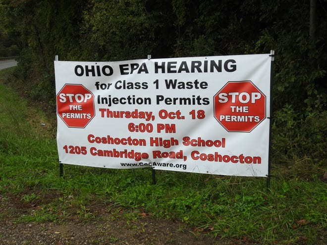 A sign sponsored by Coshocton Environmental and Community Awareness near the intersection of Ohio 83 and Otsego Avenue advertising the Ohio EPA hearing upcoming.