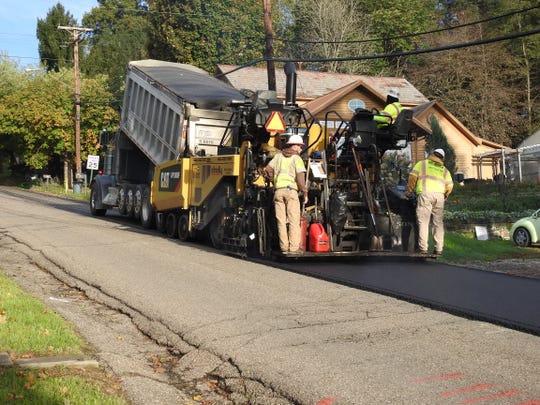 The Shelly Company paved Hill Street in Roscoe Village last week. Funding from a streets levy has allowed for increased road work for the City of Coshocton since 2015.