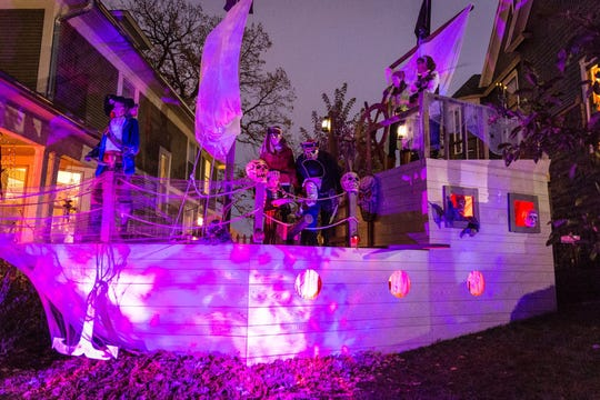 Ryan Howell, a resident of Des Moines' Sherman Hill neighborhood, set up a haunted pirate ship in his yard for the Halloween on the Hill on Oct. 31 2017. Attendees to the annual event are asked to donate an item for a food pantry before entering the haunted neighborhood.