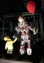 "A resident of Des Moines' Sherman Hill neighborhood set up a scene from the movie ""It"" in their yard for the Halloween on the Hill on Oct. 31 2017. Attendees to the annual event are asked to donate an item for a food pantry before entering the haunted neighborhood."