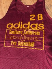 A burgundy mesh summer league jersey from former all-state basketball player Dallas Smith inspired Jon Darsee to pickup-game glory for years.