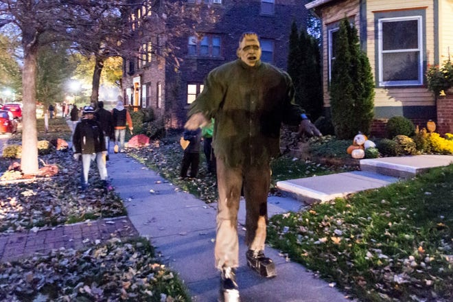 A former resident of Des Moines' Sherman Hill neighborhood returned as Frankenstein for the Halloween on the Hill on Oct. 31 2017. Attendees to the annual event are asked to donate an item for a food pantry before entering the haunted neighborhood.