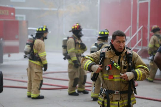 Waukee firefighters undergo a live-burn trailer training exercise on Oct. 8, 2018.