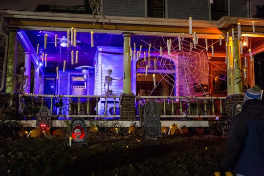 A resident of Des Moines' Sherman Hill neighborhood set up a haunted scene at their home for the Halloween on the Hill on Oct. 31 2017. Attendees to the annual event are asked to donate an item for a food pantry before entering the haunted neighborhood.