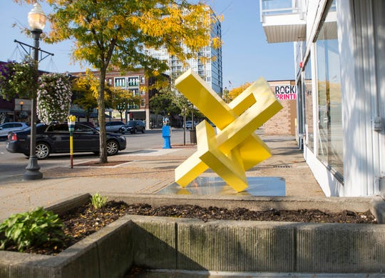 A large yellow sculpture is seen on Washington at Seventh St. in Royal Oak. Photographed on Monday, Oct 8, 2018.