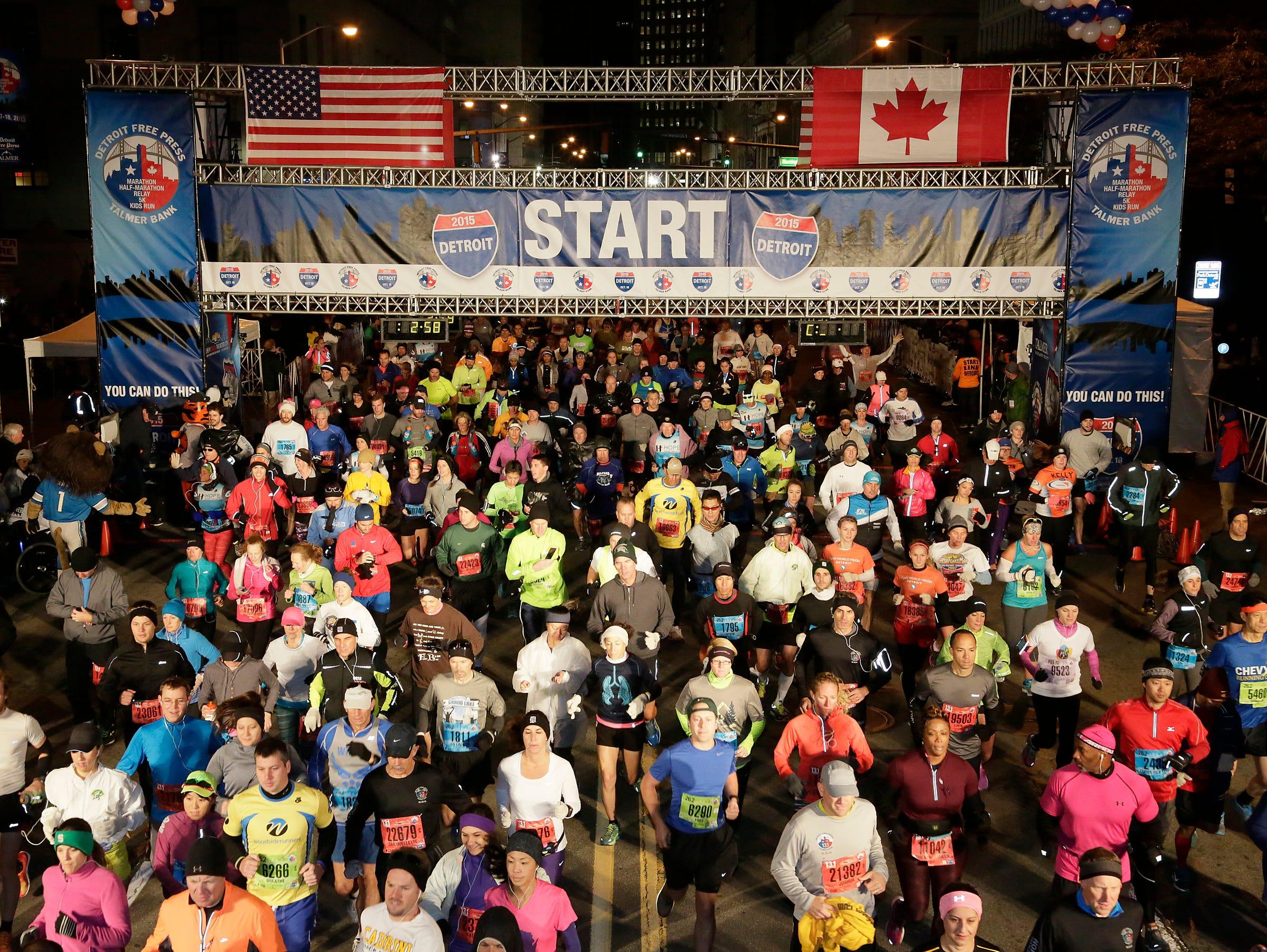 Participants begin the race at the 38th Detroit Free Press/Talmer Bank Marathon Sunday Oct. 18, 2015.