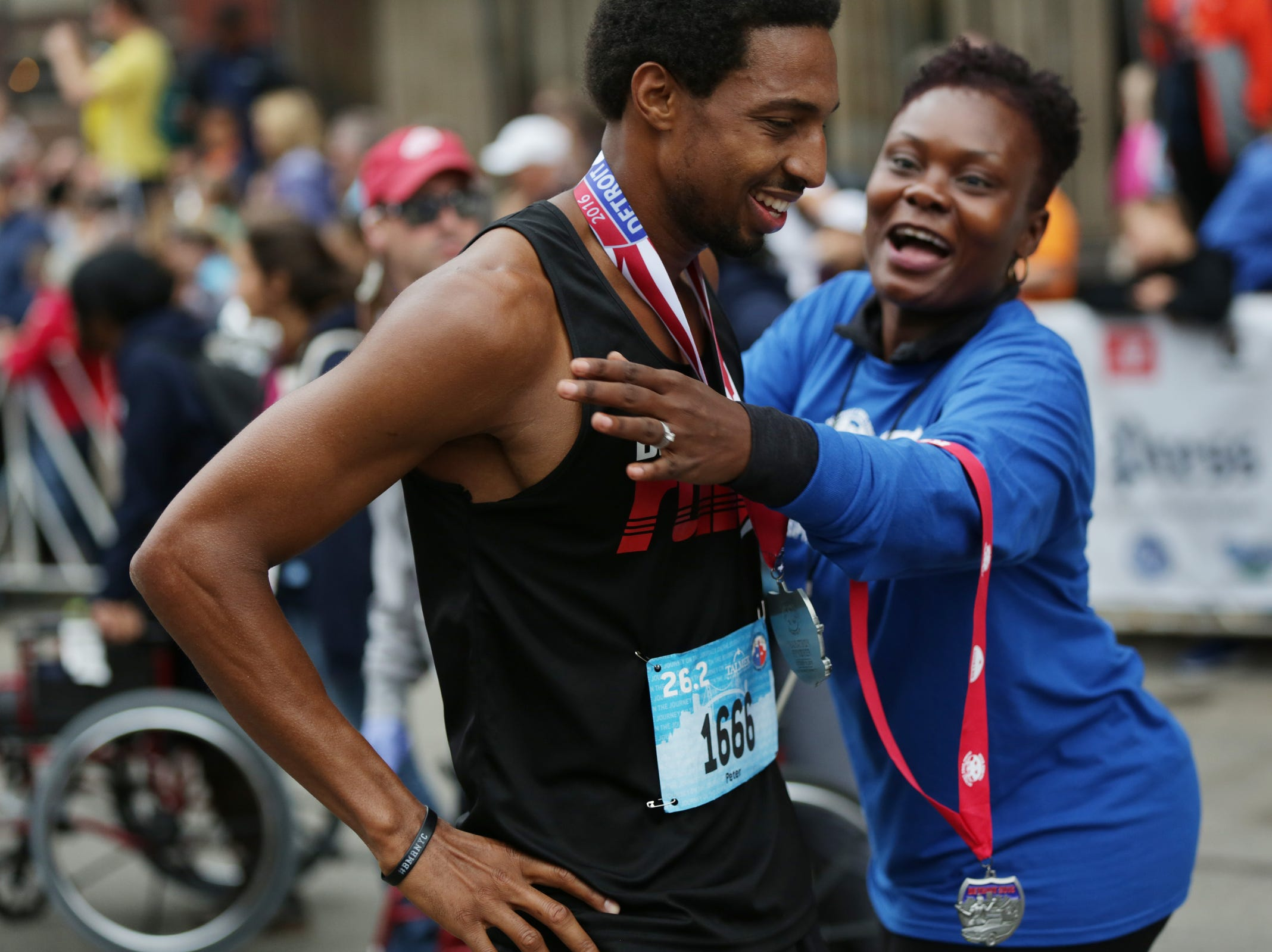 Peter Campbell of Brooklyn gets a medal after crossing the finish line during the 39th Annual Detroit Free Press/Talmer Bank Marathon in Detroit on Sunday, Oct. 16, 2016.Romain Blanquart/Detroit Free Press