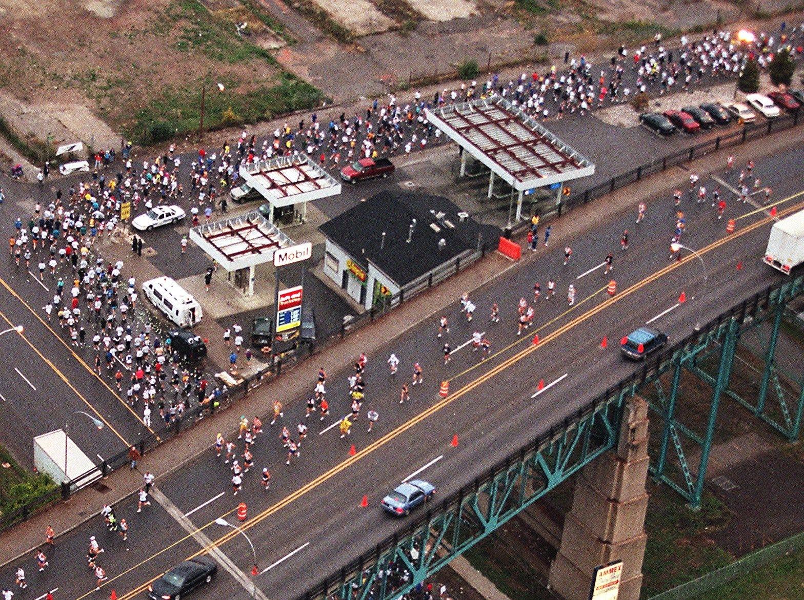 Runners make their way under and then across the Ambassador Bridge during The Detroit Free Press/Flagstar Bank International Marathon Sunday, Oct. 17, 1999, in Detroit.