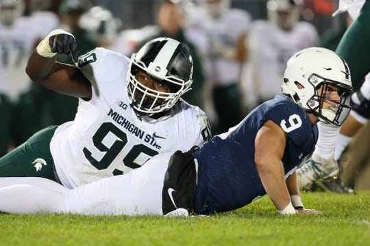 Michigan State defensive tackle Raequan Williams gestures to an official after pressuring Penn State quarterback Trace McSorley during the fourth quarter in University Park, Pa., Oct. 13, 2018.