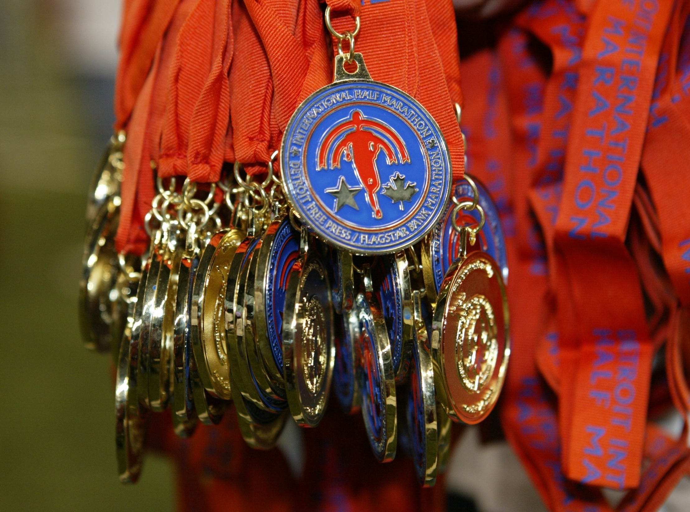 Medals await finishers as they hang at the finish lie of the 27th annual Detroit Free Press Marathon, Sunday, October 24, 2004 in Detroit, MI.