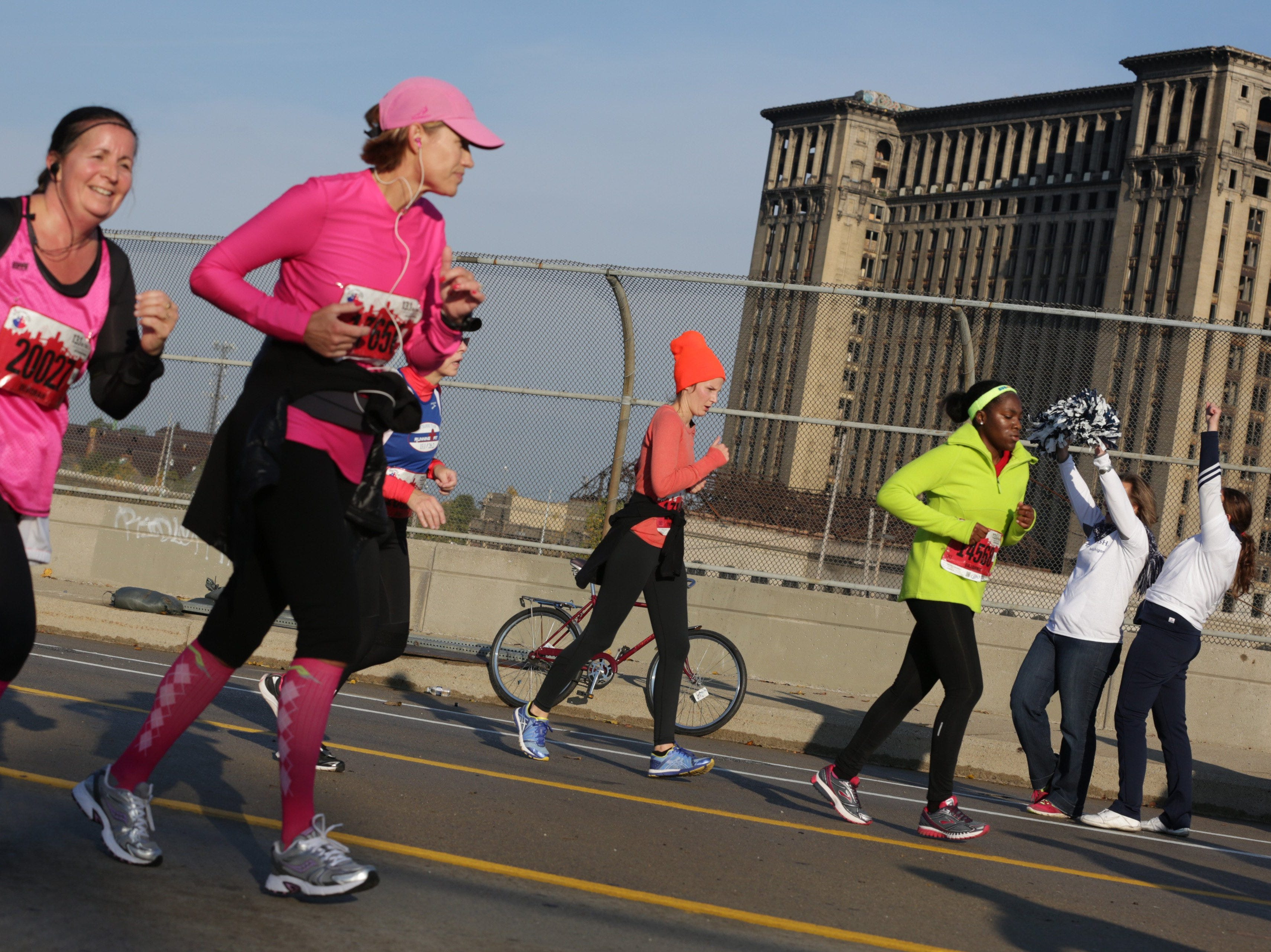 Runners on Bagley street during the 36th Annual Detroit Free Press/Talmer Bank Marathon in Detroit on Sunday, Oct. 20, 2013.
