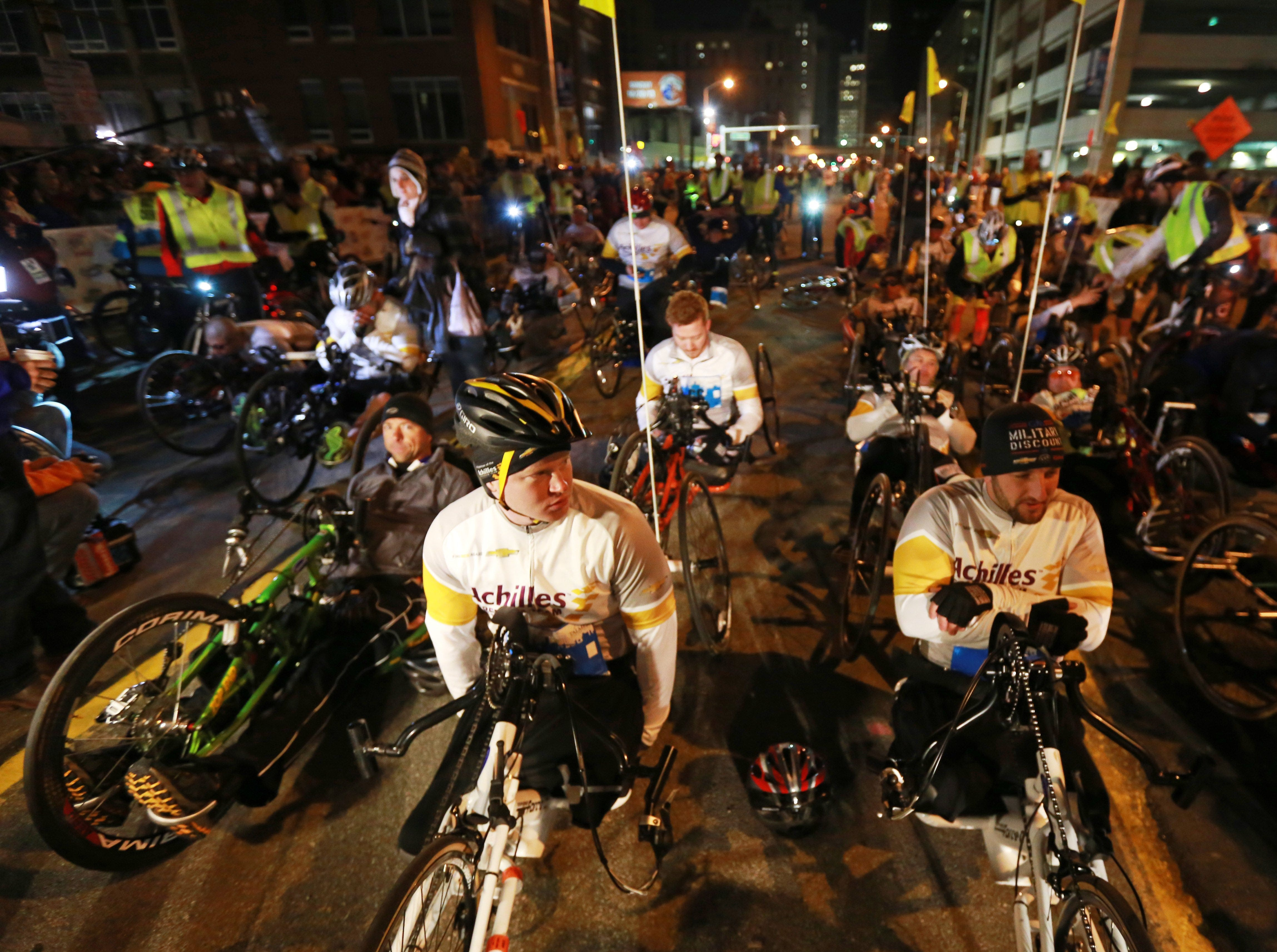 Wheelers wait for the start of their race during the 36th Annual Detroit Free Press/Talmer Bank Marathon in Detroit on Sunday, Oct. 20, 2013.