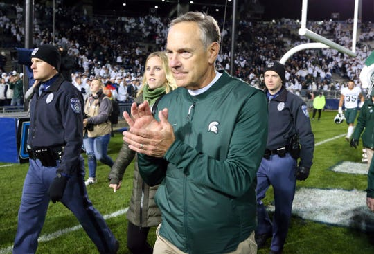 Michigan State coach Mark Dantonio walks off the field following the 21-17 win against Penn State, Oct. 13, 2018 in University Park, Pa.