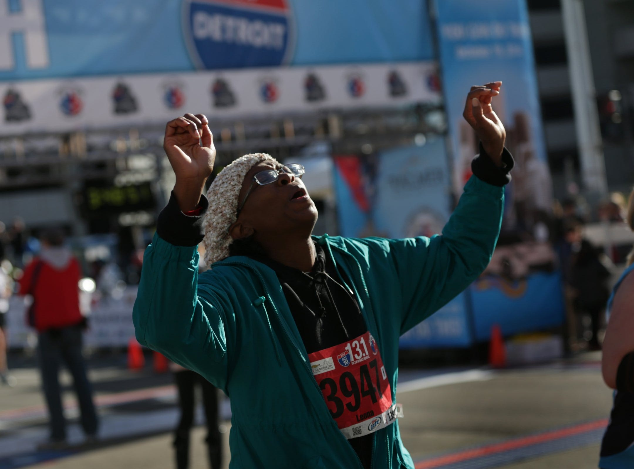 A Leona Burns of Oak Park  reacts after finishing her half marathon during the 37th Annual Detroit Free Press/Talmer Bank Marathon in Detroit on Sunday, Oct. 19, 2014.