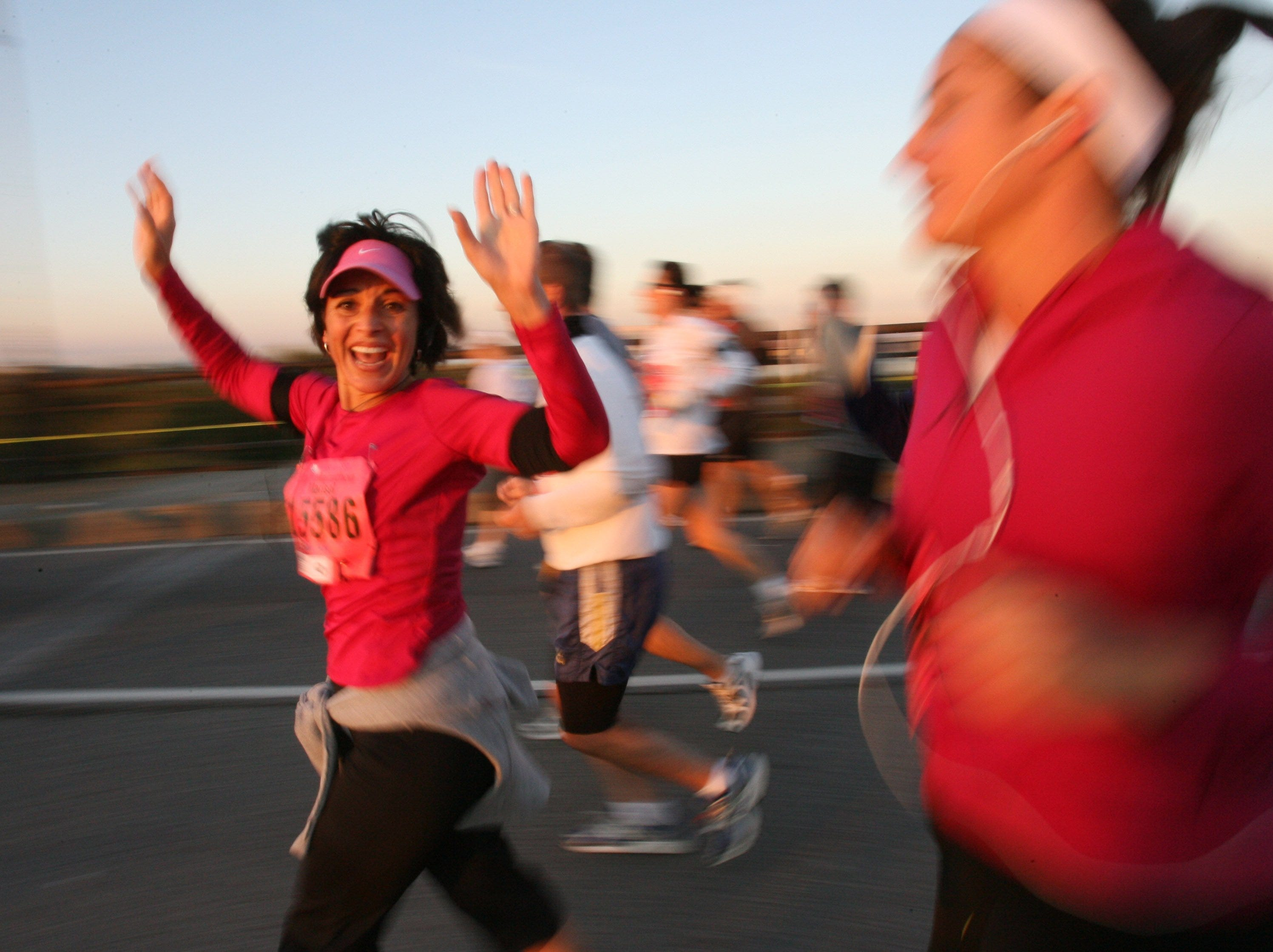 Marisol McCormick, 34, of Howell turns and waves on the Ambassador Bridge Sunday October 19, 2008 during the Detroit Free Press/Flagstar Marathon.