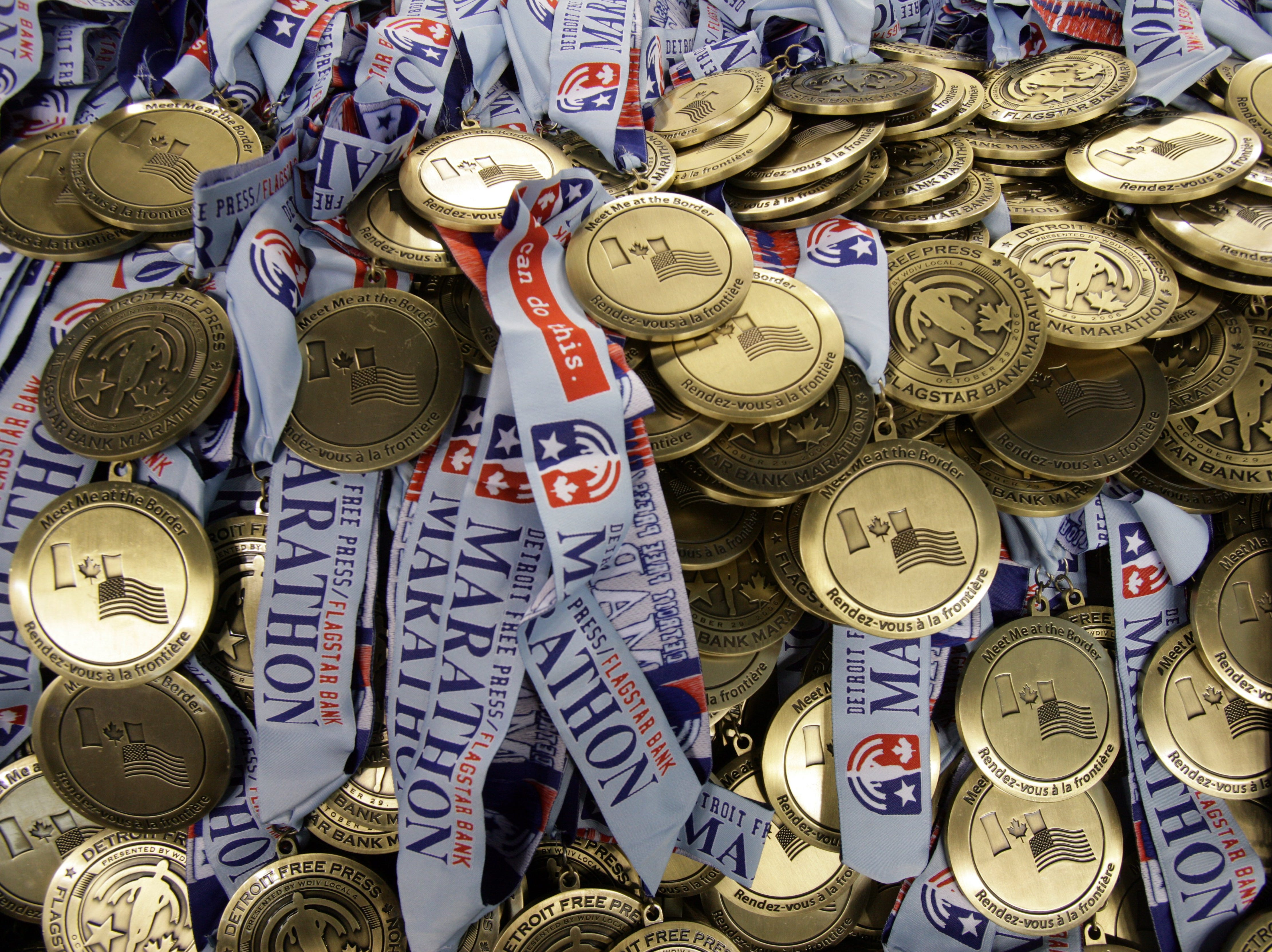 piles of medals wait for thier runners at Ford Field in Detroit during the Detroit Free Press Marathon on Sunday, October 29, 2006.