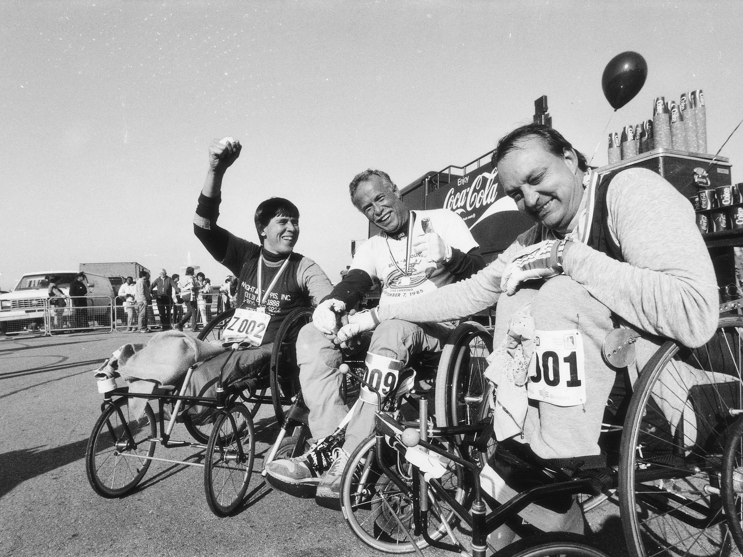 From left, Lou Chernak of Troy, Rich McAvoy of St. Petersburg, Florida and Jim Ford of Linden, celebrate finishing the Free Press Marathon in 1986.