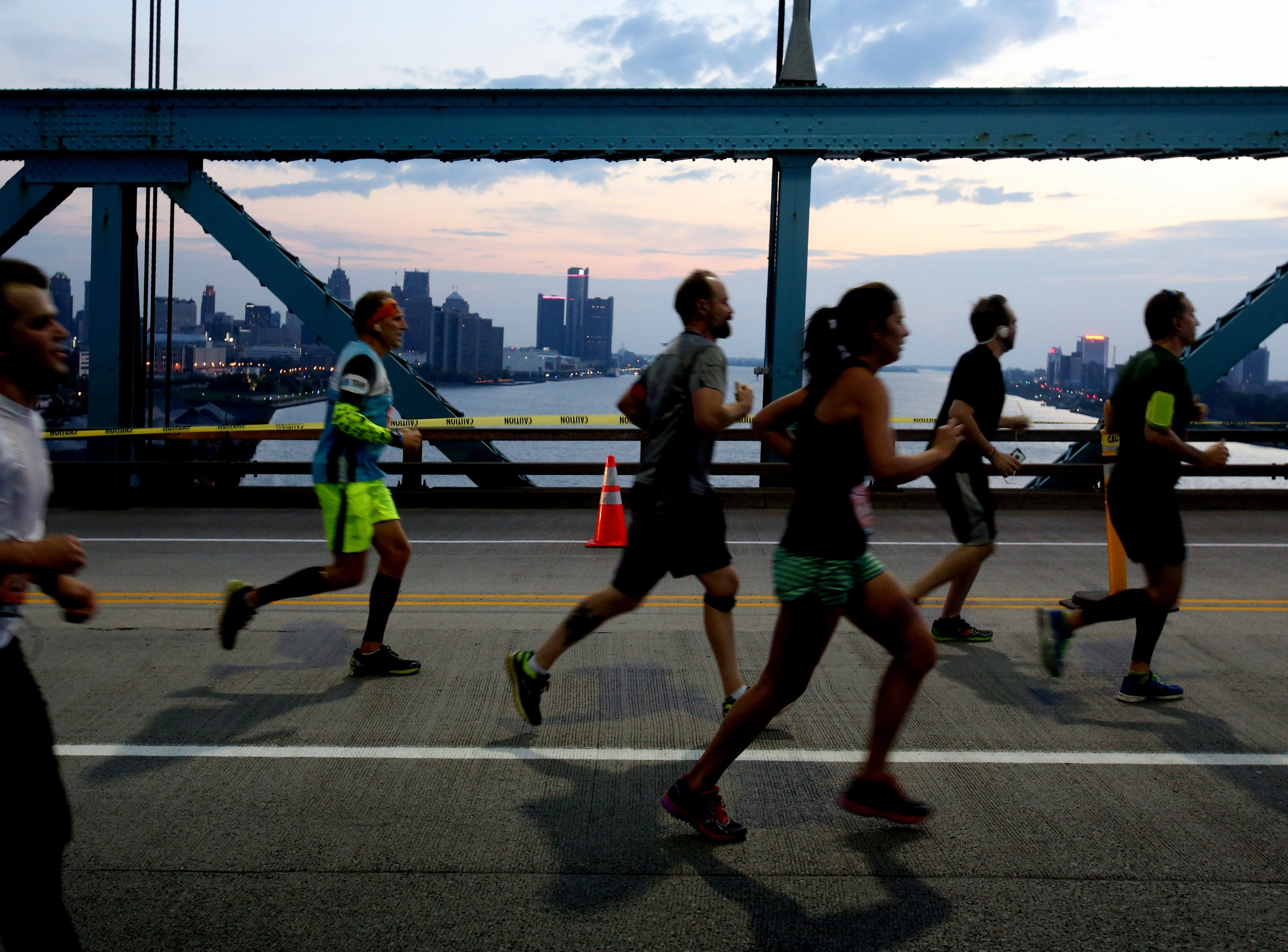With the downtown Detroit skyline in the background, runners head towards Windsor, Canada on the Ambassador Bridge during the 39th Annual Detroit Free Press/Talmer Bank Marathon in Detroit, Michigan on Sunday, Oct 16, 2016.