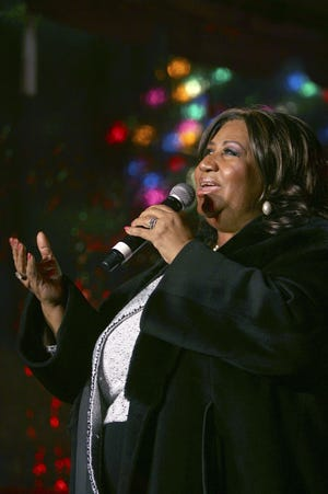 Aretha Franklin performs during the 85th annual Christmas tree lighting at the New York Stock Exchange, Thursday, Dec. 4, 2008, in New York.