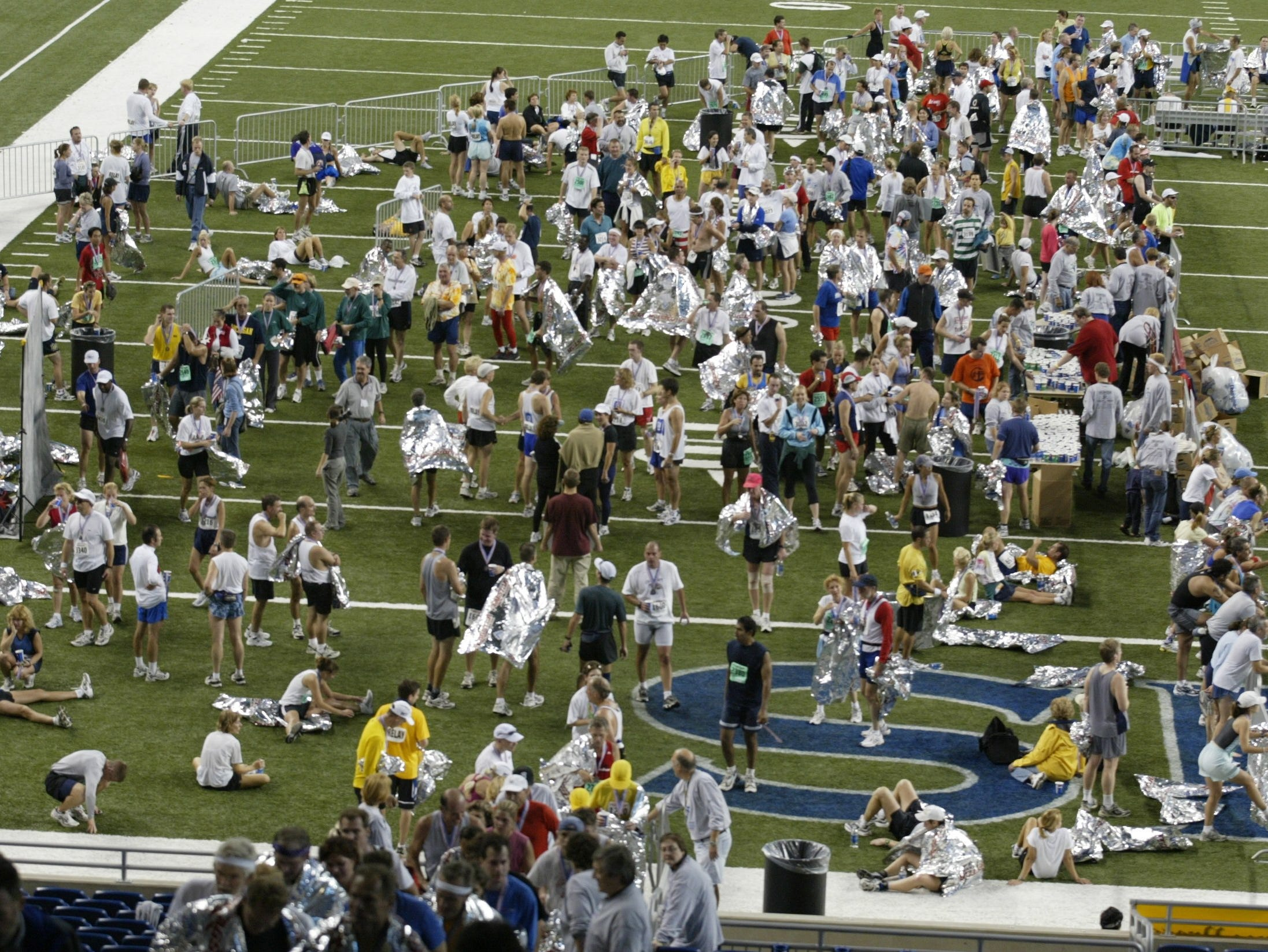 Detroit Free Press/Flagstar Bank Marathon runners cool down after finishing the race inside Ford Field on Sun Oct 5, 2002.