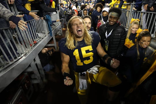 Michigan's Chase Winovich celebrates the 38-13 win over Wisconsin as he leaves the field in the Michigan Stadium tunnel Oct. 13, 2018.