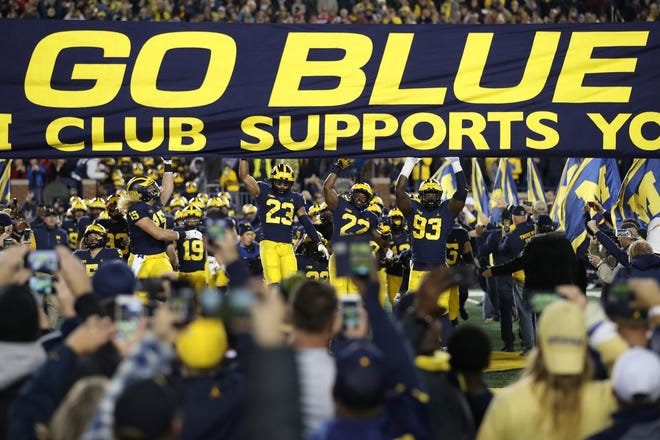 The Wolverines take the field to play Wisconsin on Oct. 13 at Michigan Stadium.