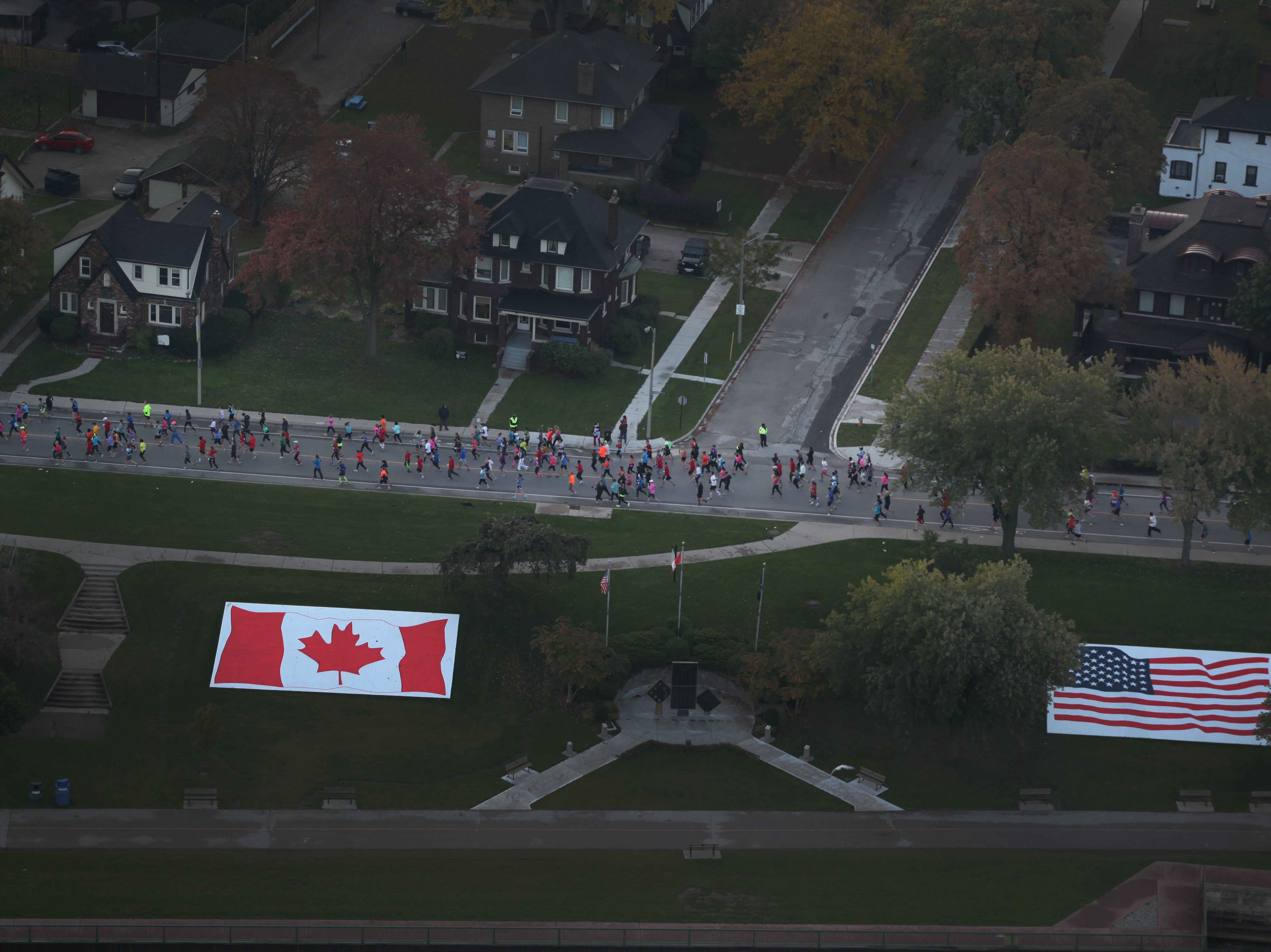 Aerial view of runners along the waterfront in Canada during the 36th Annual Detroit Free Press/Talmer Bank Marathon in Detroit on Sunday, Oct. 20, 2013.