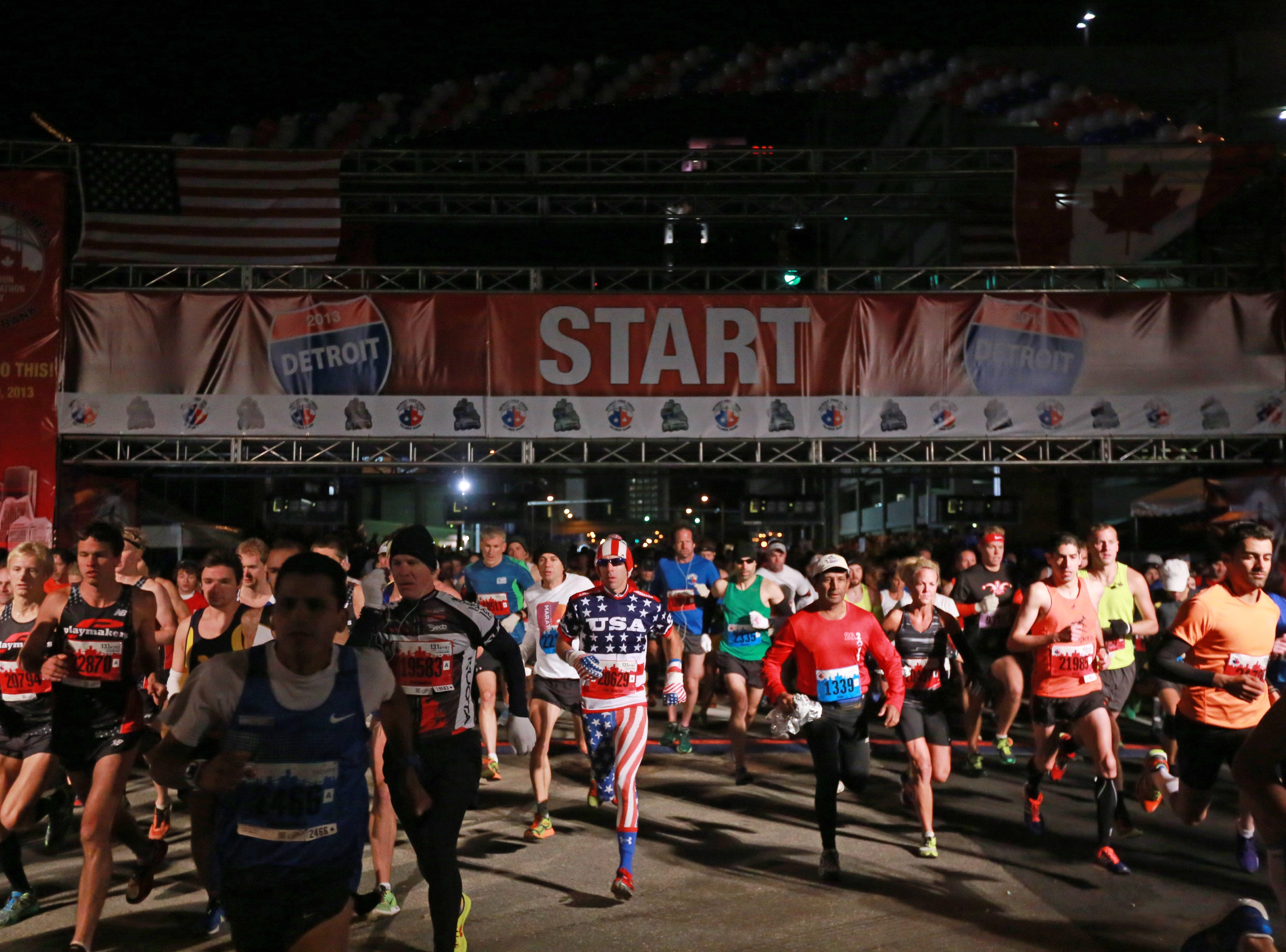Runners leave the starting line during the 36th Annual Detroit Free Press/Talmer Bank Marathon in Detroit on Sunday, Oct. 20, 2013.