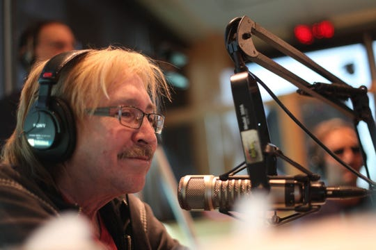 Mike Clark entertains listeners on his last show with Drew Lane at WRIF-FM, Friday May 17, 2013 in Ferndale.
