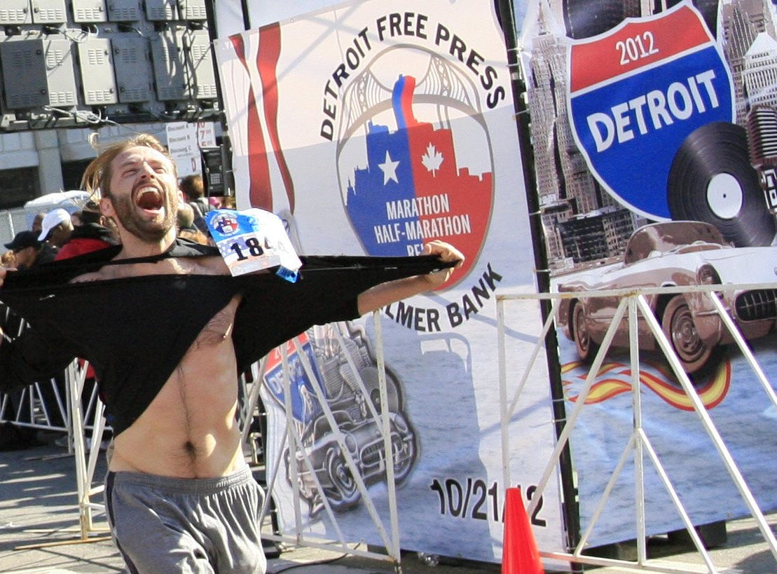 A finisher reacts at the Detroit Free Press/Talmer Bank Marathon in Detroit, Sunday, Oct. 21, 2012.