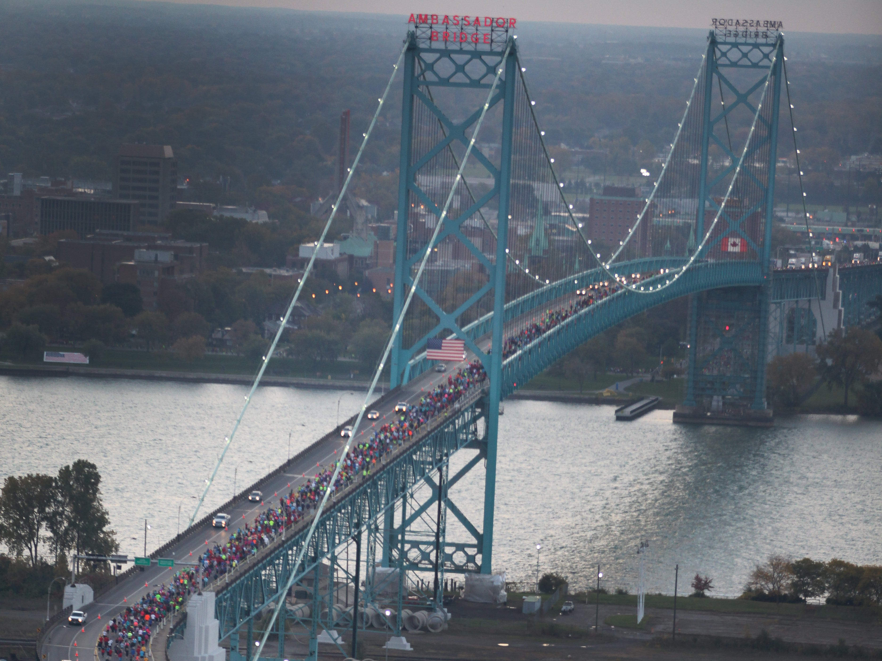 Aerial view of runners crossing the Ambassador Bridge into Canada during the 36th Annual Detroit Free Press/Talmer Bank Marathon in Detroit on Sunday, Oct. 20, 2013.