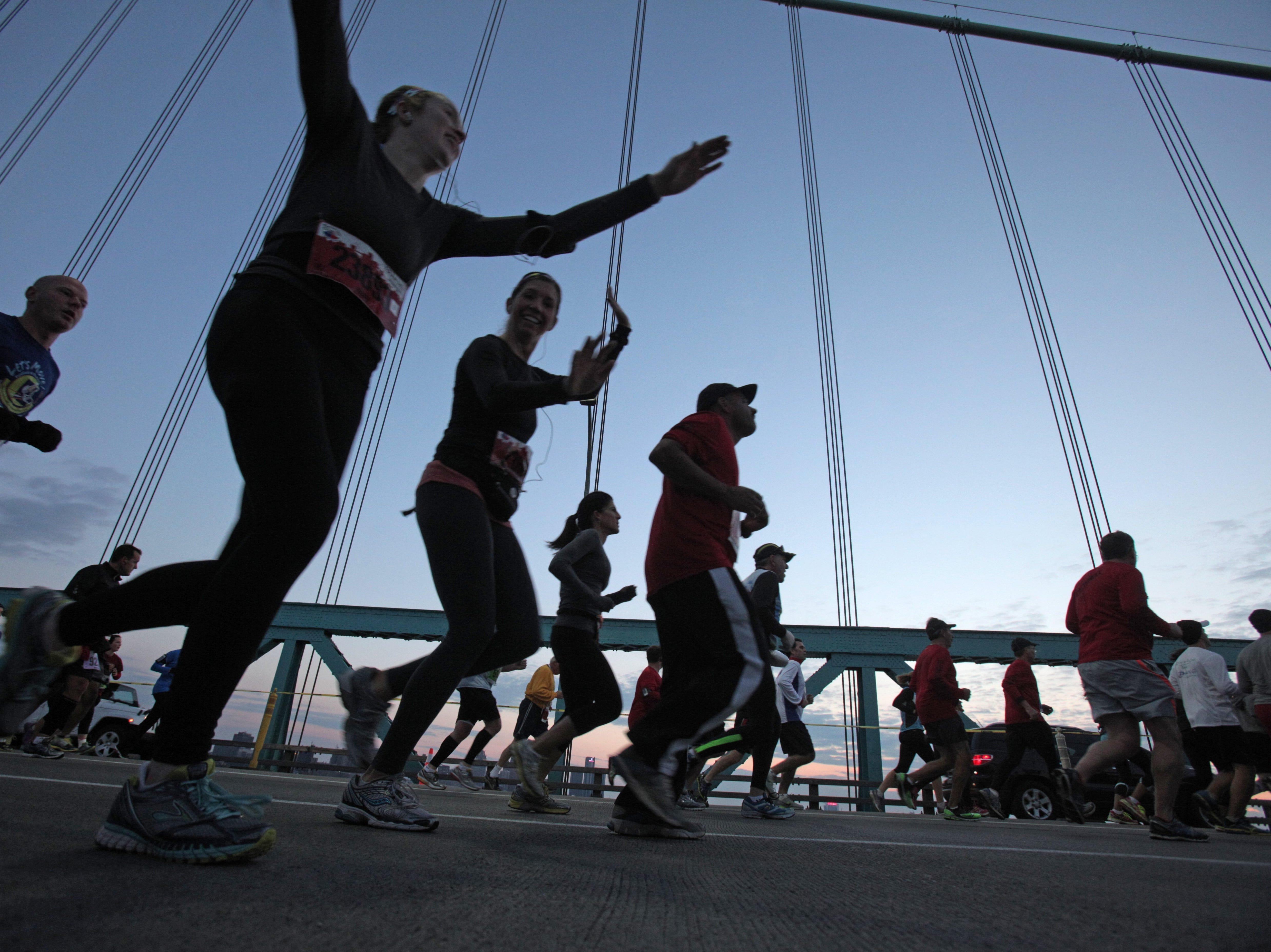 Runners run across the Ambassador Bridge during the 36th Annual Detroit Free Press/Talmer Bank Marathon in Detroit on Sunday, Oct. 20, 2013.