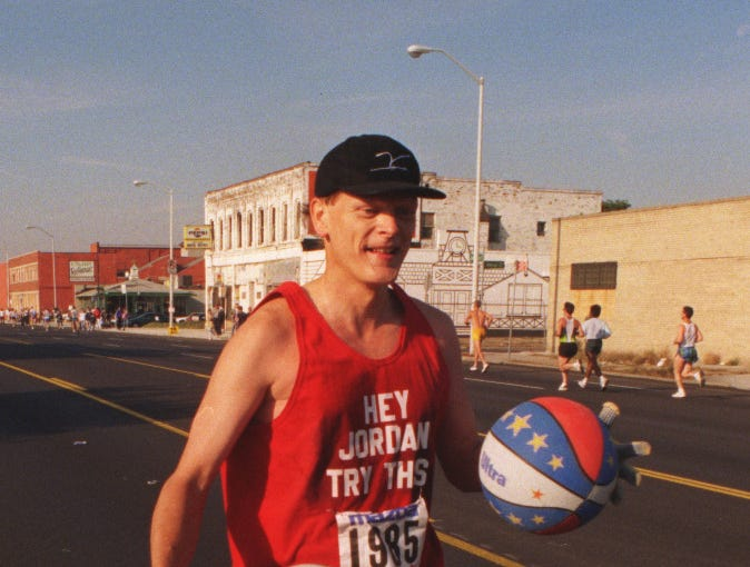 Riley McLincha runs along Jefferson on his way toward Belle Isle during the Free Press marathon in 1997. McLincha juggled three basketballs by bouncing them in a weave all along the race route.