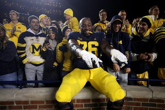 Michigan's Juwann Bushell-Beatty celebrates the 38-13 win over Wisconsin, Oct. 13, 2018 at Michigan Stadium.