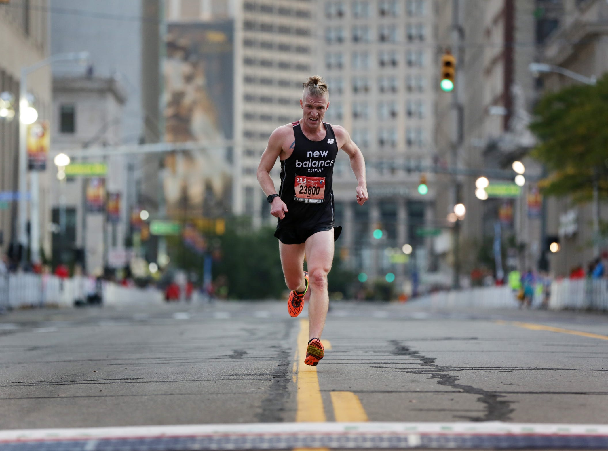 Bennett Prudhomme reaches the finish line of the half marathon during the 39th Annual Detroit Free Press/Talmer Bank Marathon in Detroit on Sunday, Oct. 16, 2016.