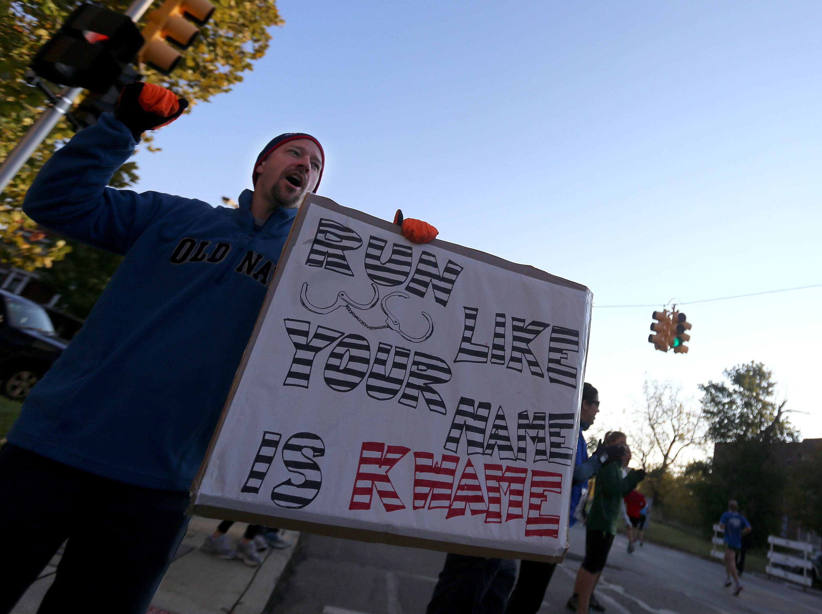 Chris Bailey, of West Bloomfield cheers on runners making their way down Lafayette during the 36th Annual Detroit Free Press/Talmer Bank Marathon in Detroit on Sunday, Oct. 20, 2013.