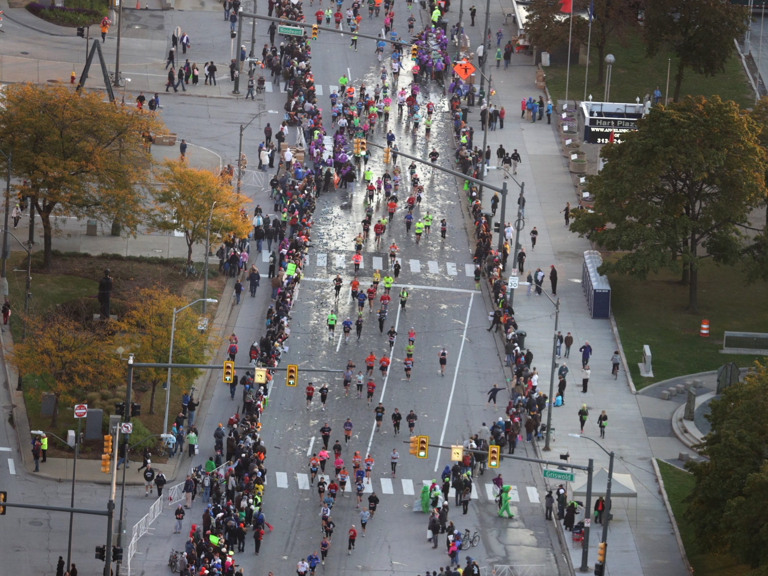 Runners come down Jefferson Avenue after exiting the Detroit Windsor tunnel  during the 36th Annual Detroit Free Press/Talmer Bank Marathon in Detroit on Sunday, Oct. 20, 2013.