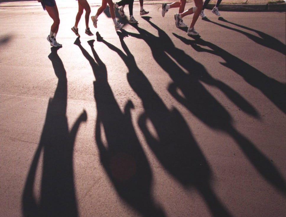 Runners shadows on Jefferson Ave. during the Detroit Free Press marathon in 1996.