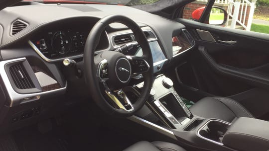 The Jaguar I-Pace First Edition's interior is trimmed in leather and wood.
