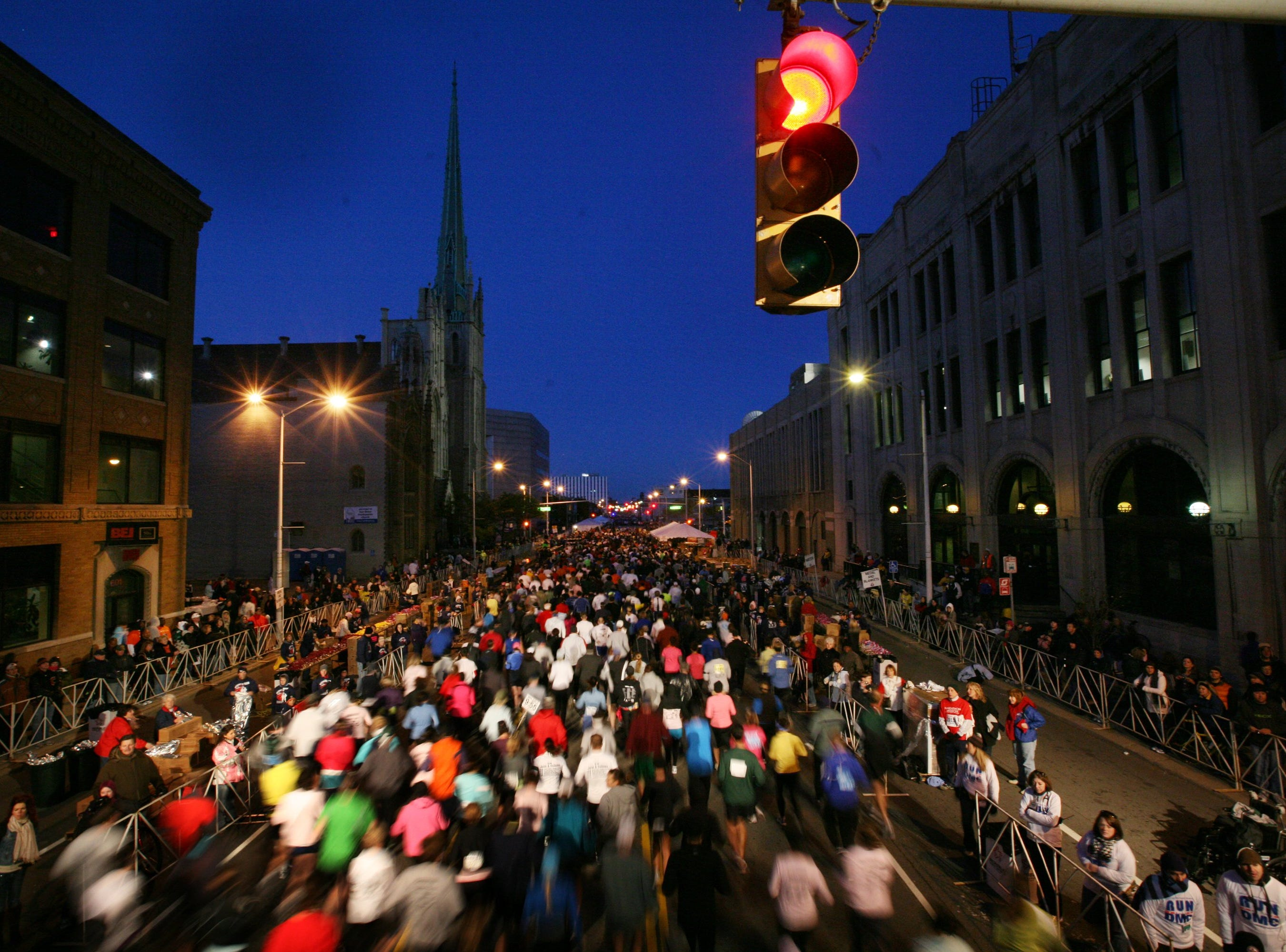 Runners make their way down Fort Street toward the Ambassador bridge at the start of the Detroit Free Press/Flagstar Marathon in Detroit, Sunday, October 18, 2009.