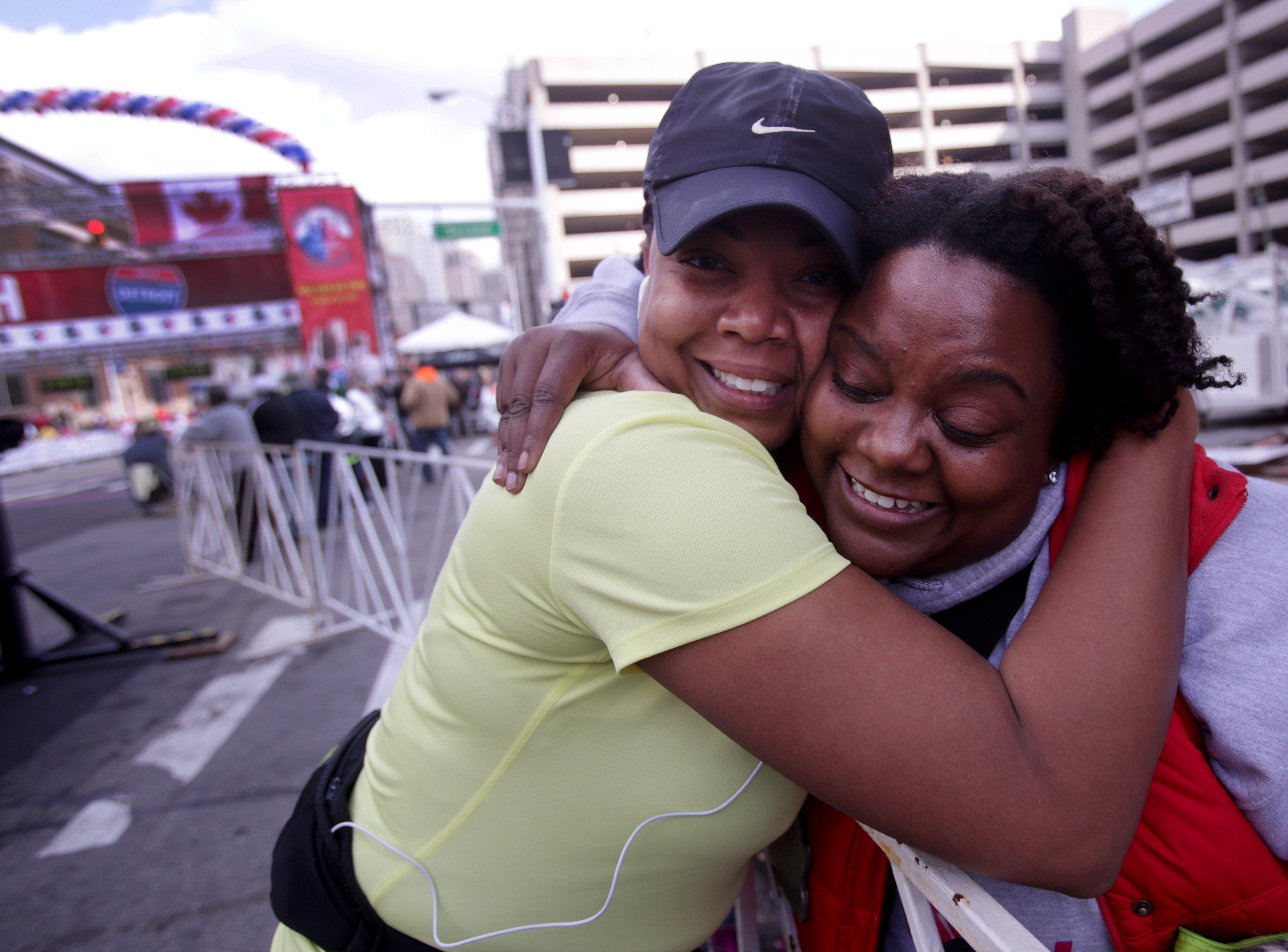Kizzi Montgomery gets a hug from her friend after she crossed the finish line at the 36th Annual Detroit Free Press/Talmer Bank Marathon in Detroit Sunday, Oct. 20, 2013.