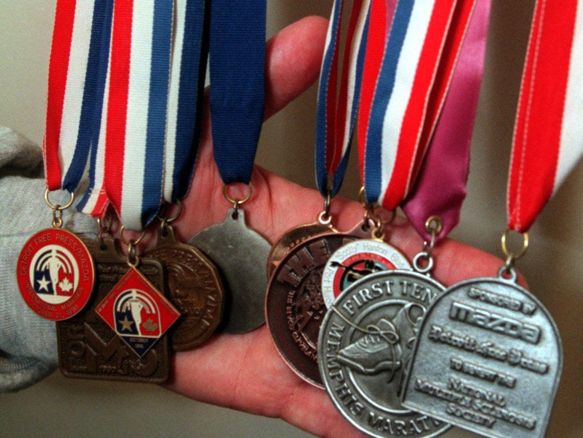 Marathon runner Rich Kieper, of Brownstown, is making a comeback after suffering years of manic depression. Here he shows off some of the many medals he has won during his racing years. He plans on running this year's Free Press Marathon.
