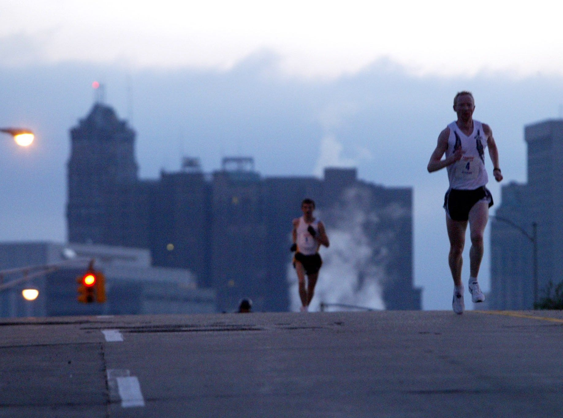 Early in the race, Andrei Gordeev of Minsk, Belarus, front, pulled ahead of Alexey Veselov of St. Petersburg Russia, and commanded a significant lead throughout and ultimately won the 28th annual Detroit Free Press Marathon, Sunday, Oct. 23, 2005.