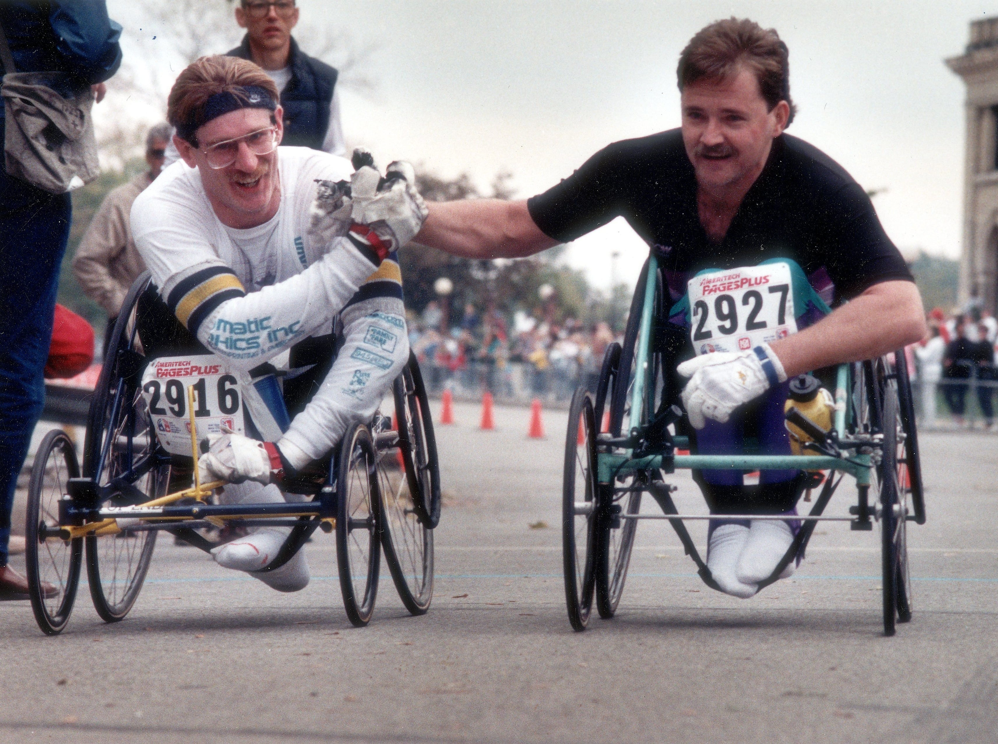 1988 Free Press Marathon Chuck Patton of Belding, left, and Gene Root of Livonia congratulate each other as they cross the finish line with a time of 2:28.25.