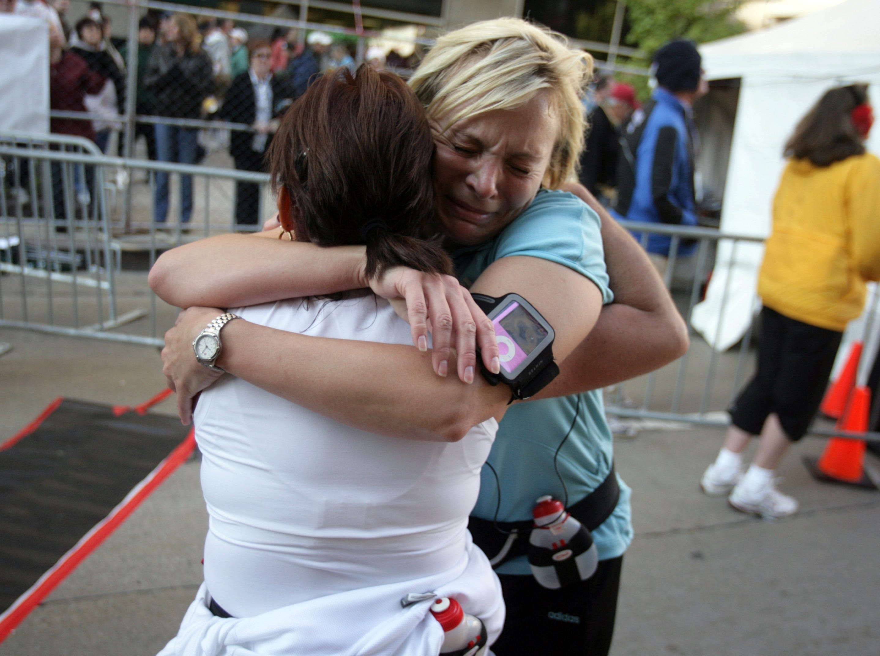 Cathy Vilag CQrr and Ena Monteleone, both of Amherstburg, Ontario hug each other at the finish line of the Detroit Free Press/Flagstar Marathon on Sunday, October 19, 2008 in Detroit.