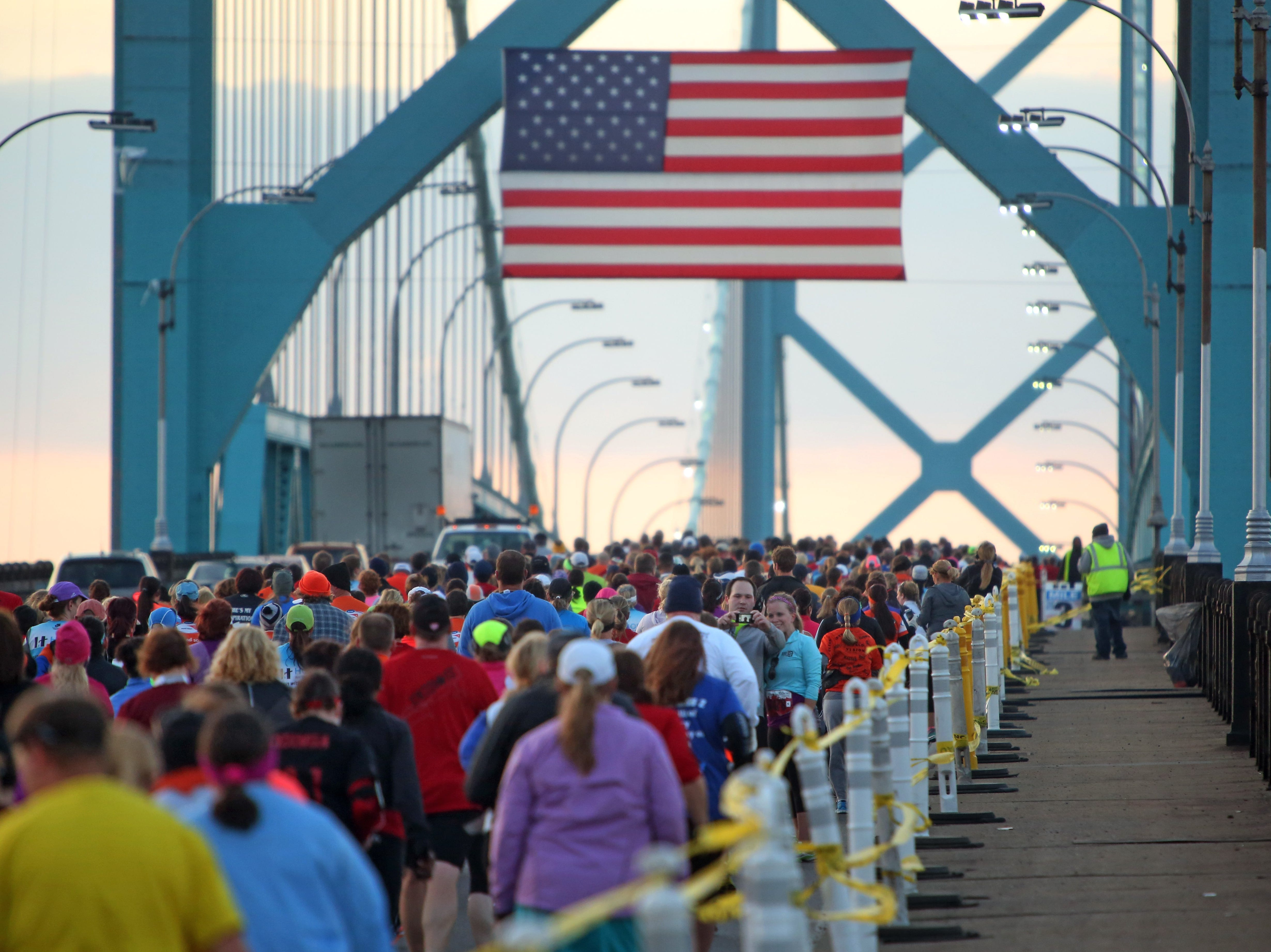 Runners run across the Ambassador Bridge during the 36th Annual Detroit Free Press / Talmer Bank Marathon in Detroit on Sunday, Oct. 20, 2013.
