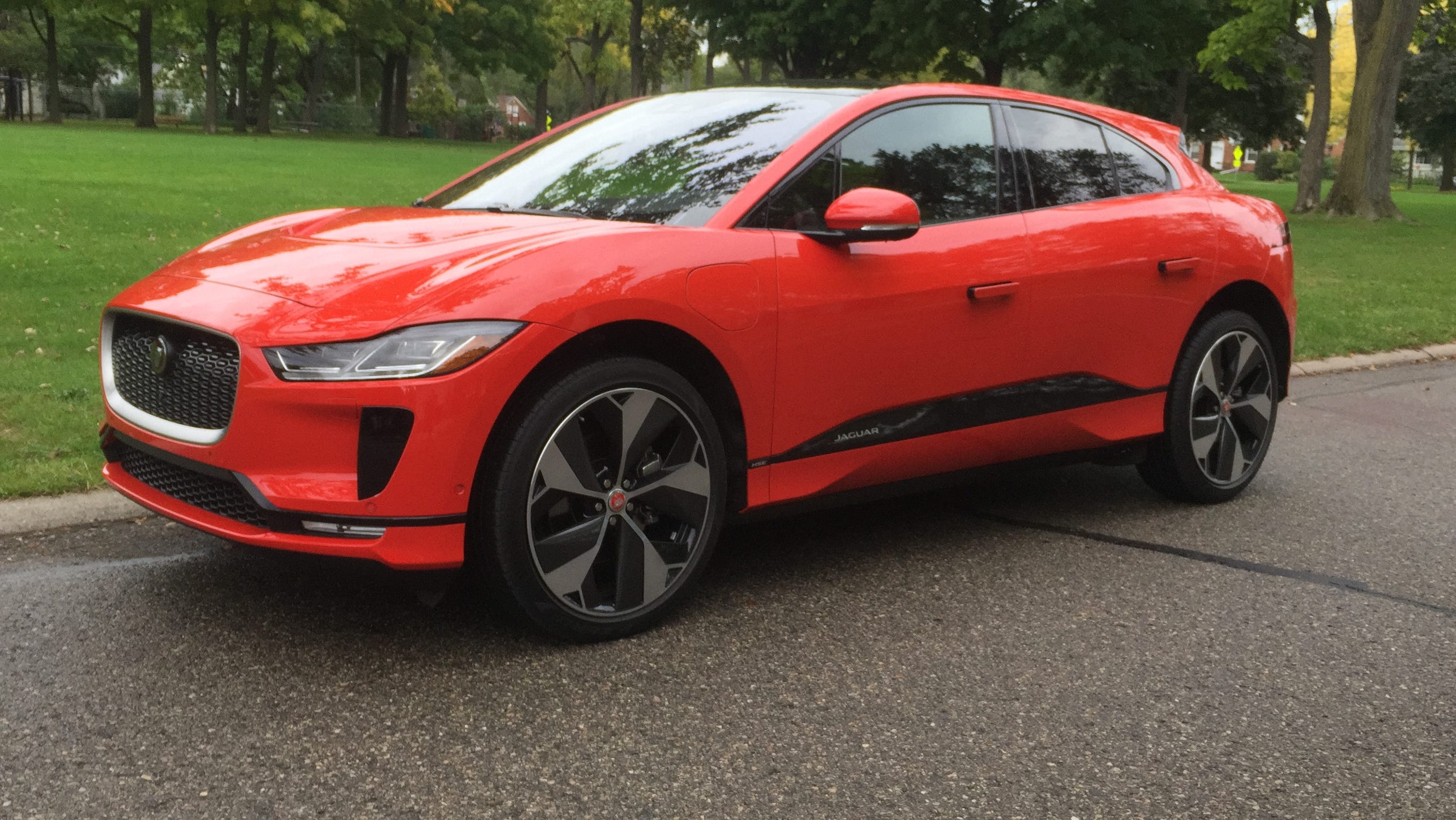 The 2018 Jaguar I-Pace electric SUV has a low roofline and sleek looks.